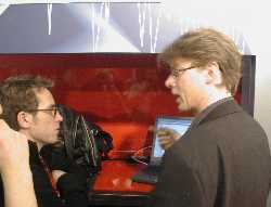 Erik Brataas - Phonofile delegate to Midem 2003 busy explaining the qualities of Musiconline.no to Belgian delegates